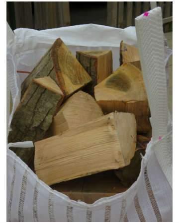 seasoned firewood logs barrow bag side