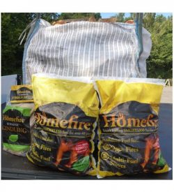 Homefire coal, hardwood firewood logs. with kindling and firelighters bundle